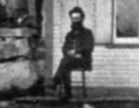 Sullivan M. King in front of hishome/saloon